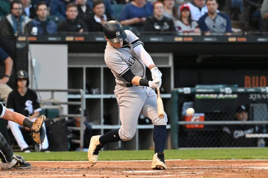 June 13, 2019; Chicago, IL, USA; New York Yankees designated hitter Clint Frazier (77) hits an RBI single during the second inning against the Chicago White Sox at Guaranteed Rate Field. Mandatory Credit: Patrick Gorski-USA TODAY Sports