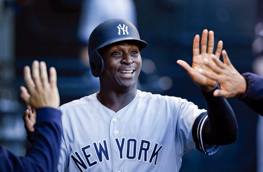 New York Yankees' Didi Gregorius celebrates in the dugout after scoring during the second inning against the Chicago White Sox in a baseball game Thursday, June 13, 2019, in Chicago. (AP Photo/Nuccio DiNuzzo)