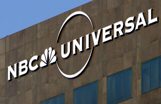 In this Dec. 3, 2009, file photo, the NBC Universal logo hangs on a building in Los Angeles. NBCUniversal announced plans Friday, June 14, 2019, for a state-of-the-art television and film studio in a warehouse district just north of downtown Albuquerque.