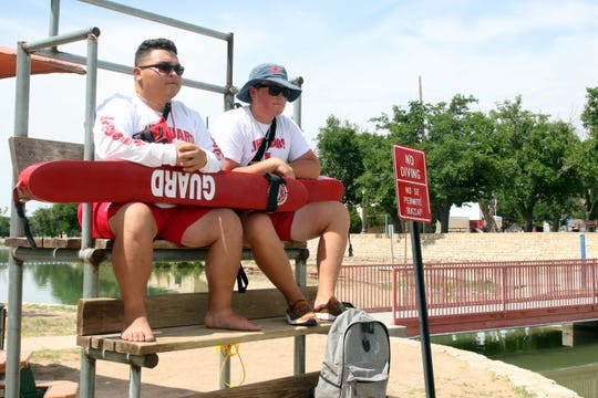 Andrew Easley, left, and Mason McGeath, right, stand guard at the Pecos River on Friday. Lifeguards working the Pecos River save about 50 people a year from various water accidents and incidents.