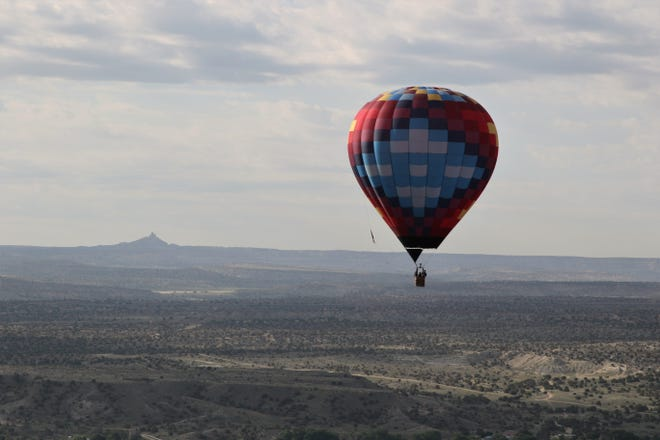Angel Peak is seen in the background as a hot air balloon flies near Bloomfield. A bill that would allow the state to adopt air quality standards more stringent than federal standards is headed to the governor's desk.