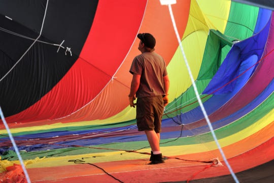 Pilot Ian Whitling sets up his balloon, Roy-G-Biv, Friday, June 14, 2019, during the San Juan River Balloon Rally.
