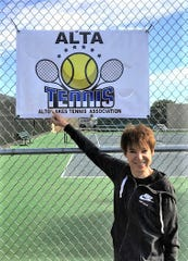 ALTA member Shelley Stern proudly shows off our new banner which she designed. It will hang on the Alto courts.