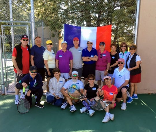 Beneath the French Tri-color, ALTA members toast the beginning of summer Grand Slam excitement at their annual French Open brunch and mixer.