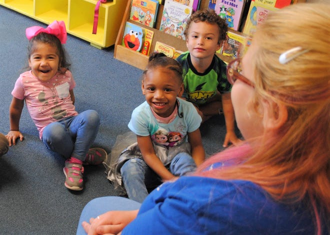 Children learning at TLC Preschool during its last day of operation on June 14.