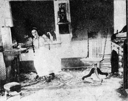 Izola Fontenot Campbell, one of the first telephone operators in town, at the first switchboard of the Bertha Telephone Company in Opelousas in the early 1900.
