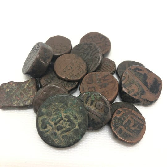 These ancient coins from India date back nearly to Christ's time.