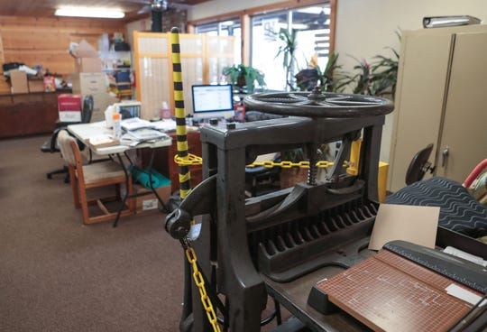 A paper cutter sits in the newsroom of the Idyllwild Town Crier newspaper, June 13, 2019.
