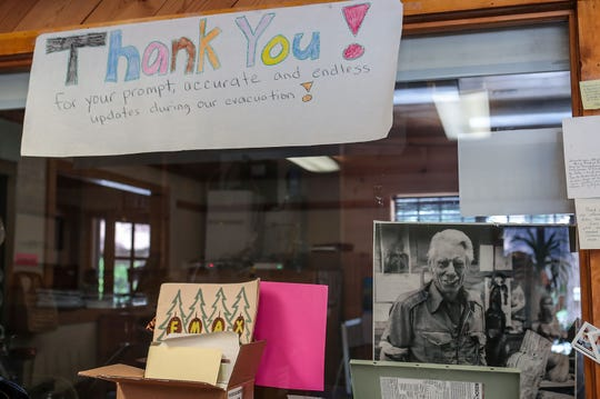A photo of the Idyllwild Town Crier founder Ernie Maxwell sits in the newsroom of the Idyllwild newspaper, June 13, 2019.