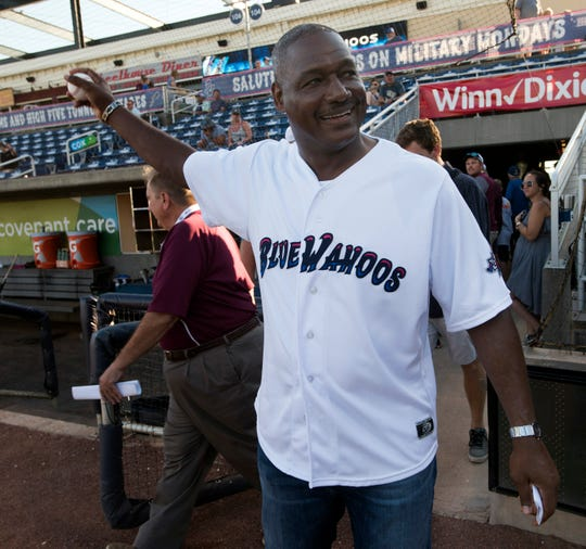 Pensacola native and NFL Hall of Famer Derrick Brooks loosens up his arm before tossing out a ceremonial first pitch to kick off the Blue Wahoos homestand on Thursday, June 13, 2019.