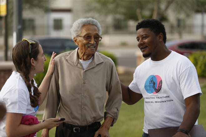 ASU theater grad students Donta McGilvery (right) and Claire K. Redfield greet former Phoenix Councilman Calvin C. Goode as he comes to see a performance at Eastlake Park in Phoenix in 2019. McGilvery and Redfield founded the theater group to help tell the story of the neighborhood.