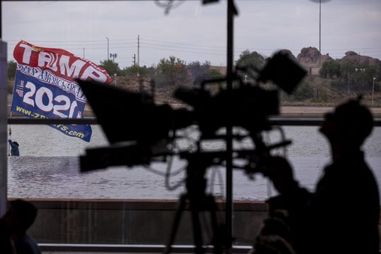 A person holds a Trump flag outside during FOX News Channel's America's Election HQ Town Hall with 2020 Democratic Presidential candidate Julian Castro on Thursday, June 13, 2019, at the Tempe Center for the Arts in Tempe, Ariz.