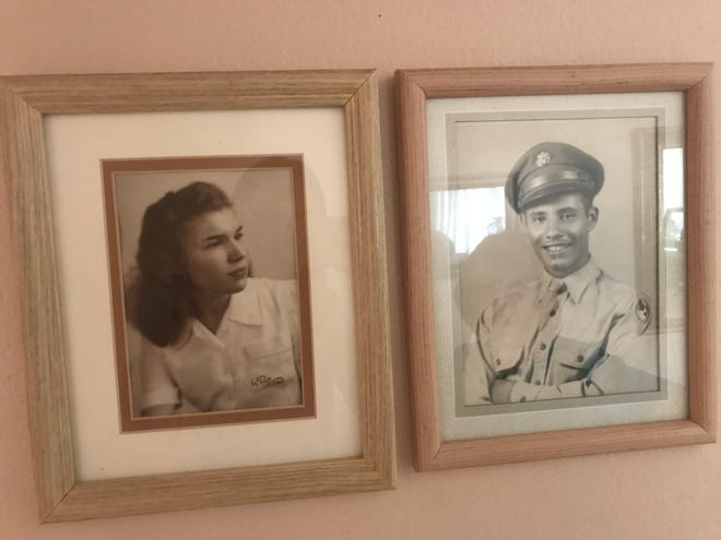 Photos of Gloria Arroyo and her husband, Sonny, hang in the hallway of Arroyo's Phoenix home.
