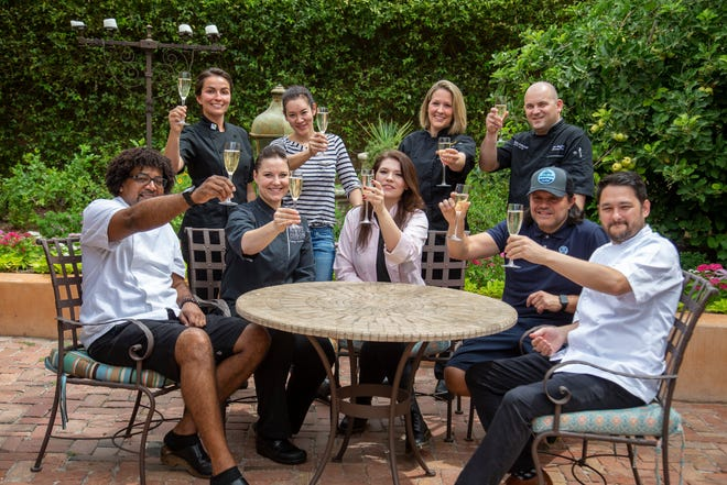 Chefs selected to prepare the gala dinner and reception for the James Beard Foundation Taste America Phoenix event raise a glass.
