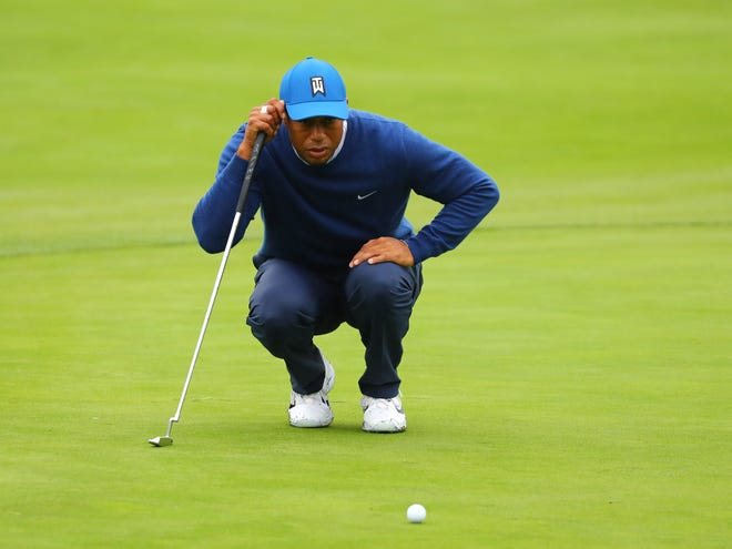 June 14, 2019; Pebble Beach, CA, USA; Tiger Woods lines up a putt on the 11th green during the second round of the 2019 U.S. Open golf tournament at Pebble Beach Golf Links.