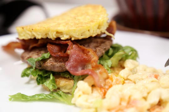 A ramen burger from The Coffee Bean Cafe in the City of Poughkeepsie on June 14, 2019. This hamburger's bun is made of ramen noodles.