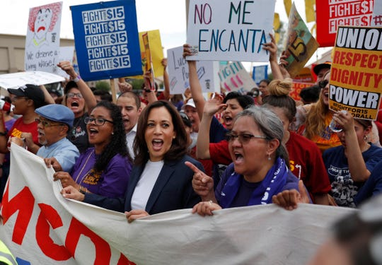 Democratic presidential candidate Sen. Kamala Harris, center-left, D-California, marches with people protesting for a higher minimum wage outside McDonald's, Friday, June 14, 2019, in Las Vegas. (AP Photo / John Locher)