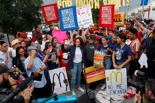 Democratic presidential candidate Sen. Kamala Harris, center, D-Calif., speaks to people protesting for higher minimum wage outside of McDonald's, Friday, June 14, 2019, in Las Vegas. (AP Photo/John Locher)