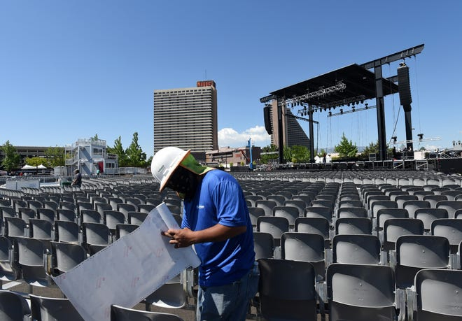 A worker attaches numbers to the floor seats at new Nugget Events Center on the eve of opening day. The center open on Saturday June 14, with a block party that starts at 4 p.m. with food trucks and beverage booths. The music starts at 7 p.m. with Contry stars Margan Eve and Toby Keith at approximately 8 p.m.