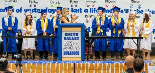 Graduates receiving advanced diplomas are congratulated by Smith Valley Principal Kathy Bomba-Edgerton.