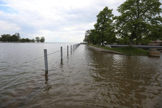 A high Lake Ontario has overflowed the Genesee River where they meet, causing flooding at the Genesee River Fishing Access Site in Irondequoit.