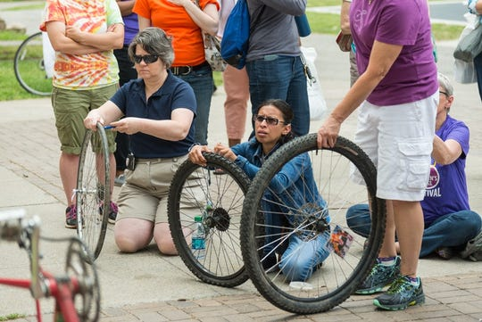 Attendees of the first Rochester Women's Bike fest learned how to repair flat tires and maintain their bikes.