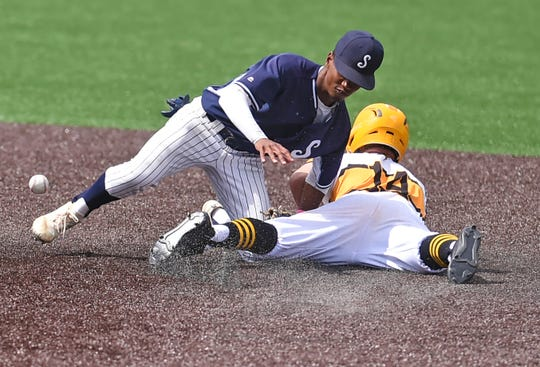 Suffern's Kenny Dodson (1) looks to tag McQuaid's Jack Beauchamp (14) out at second base during Friday's state Class AA semifinal game at Binghamton University. McQuaid won 4-3.