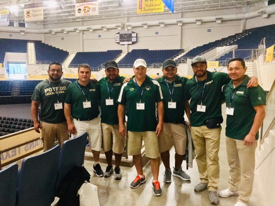 "The coaching staff for the ""American football"" team at the Universidad Autónoma del Estado de México regularly attends the Angelo Football Clinic at Angelo State University's Junell Center."