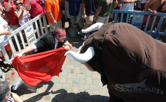 Here's a look back at photos from past year's Running of the Bull events.