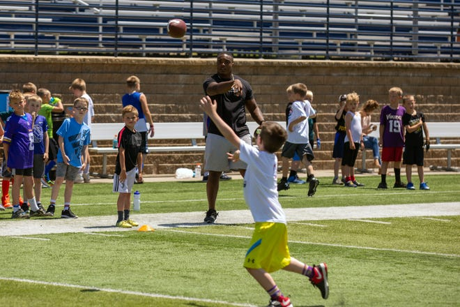 Minnesota Vikings FB CJ Ham throws a pass to a camper during the 20th Annual Legends for Kids Football camp at Augustana University.