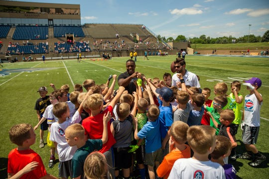 Minnesota Vikings FB CJ Ham breaks down the huddle with campers during the 20th Annual Legends for Kids Football camp at Augustana University.