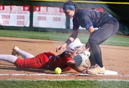 Riverheads' Cheyenne Deming is safe on first as Auburn's Adyson Huff drops the catch in the semifinal game in the VHSL Class 1A state softball tournament in Radford on Thursday, June 13, 2019.