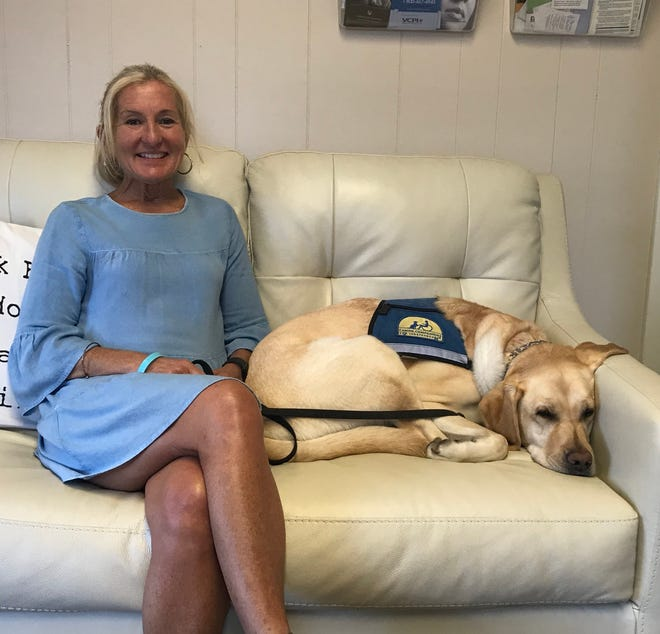 "Janet Mizzi-Balser, director of Staunton's Victim-Witness Program, is shown with her facility dog ""Murph"" on Thursday, June 13, 2019."