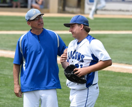 Alec Dietl meets with coach Mike Beier in the third inning of the Class AA State Consolation Semifinals, Friday, June 14 at Joe Faber Field.