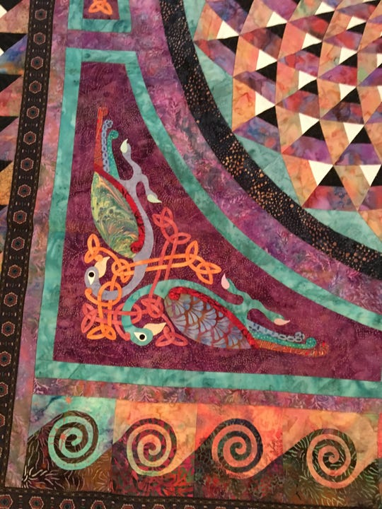 Detail from one of Linda O'Sullivan's quilts showing birds and Celtic designs. Recently Quilters Unlimited worked together to make quilts for veterans, as well as a neo-natal unit in Haiti.