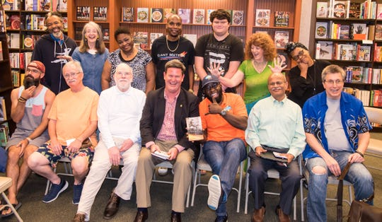 Mayor John Dailey attends a meeting of the Big Bend Poets and Writers.