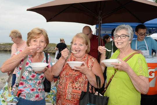 Diane and Gail Brickey, left, and Elaine Nash enjoy their soup at Treasure Coast Food Bank's Empty Bowls event in downtown Fort Pierce.
