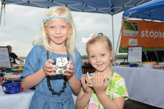 Caroline and Eloise Voss with their bowls at Treasure Coast Food Bank's Empty Bowls event in downtown Fort Pierce.