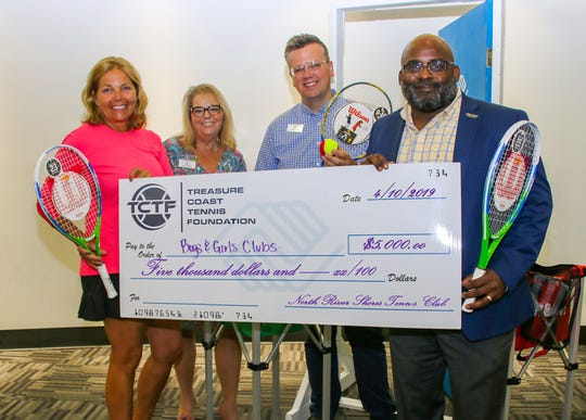 Karin DeCoste, left, president of Treasure Coast Tennis Foundation, presents a check for $5,000 to representatives from Boys & Girls Clubs of St. Lucie County Joan Friedman, Tommy John and Will Armstead.