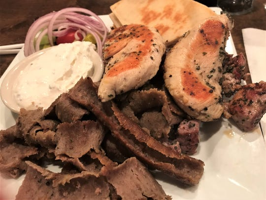 Spiro's Taverna serves a trio platter of seasoned gyro meat, souvlaki and chicken, which is superb.