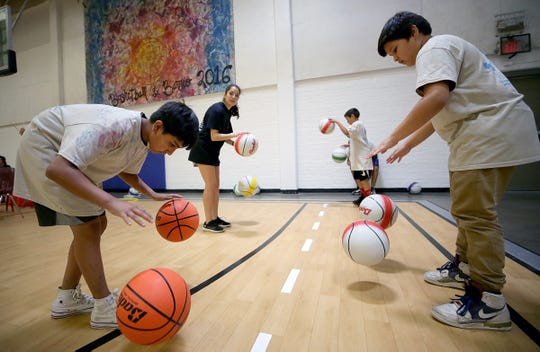 Children learn dribbling skills during Basketball in the Barrio, which kicked off Friday, June 14, 2019, at the Armijo Recreation Center in South El Paso. The camp wraps up Sunday.