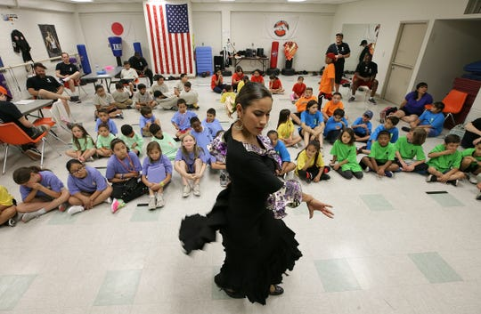 A dancer demonstrates her skills for children attending Basketball in the Barrio on Friday, June 14, 2019, at the Armijo Recreation Center in South El Paso.