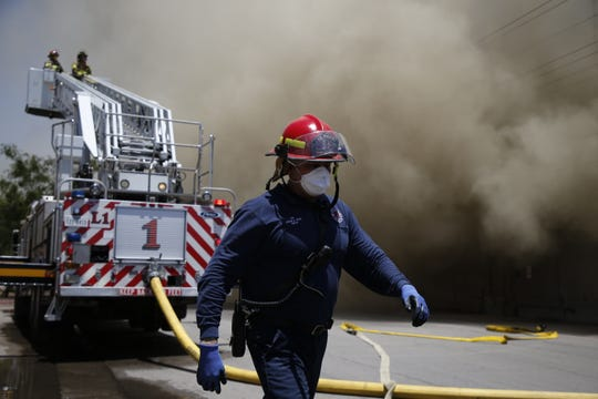 El Paso firefighters battle a blaze at the W. Silver Recycling plant at 1404 Olive Ave. on Friday afternoon, June 14, 2019.