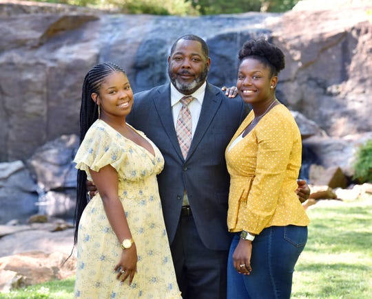 Kelly Walker, middle, with his daughters Bria Walker, left, and Chelsea Mangrum, right,