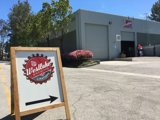 Signs point the way to the Westlake Village business-park location of Westlake Brewing & Libations during the business' second-anniversary party in April 2018. The combination restaurant, live-music venue and microbrewery has since closed.