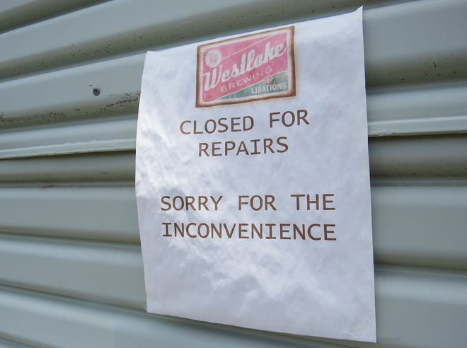 """A """"closed for repairs"""" sign greets would-be patrons at Westlake Brewing & Libations this week in Westlake Village. According to posts made to its Facebook and Instagram pages on June 7, the business is permanently closed."""