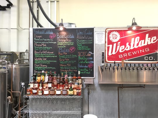 Beer, wine, cider and cocktails are listed on the chalkboard menu at Westlake Brewing & Libations during the business' second-anniversary party in April 2018. The combination restaurant, live-music venue and microbrewery has since closed.