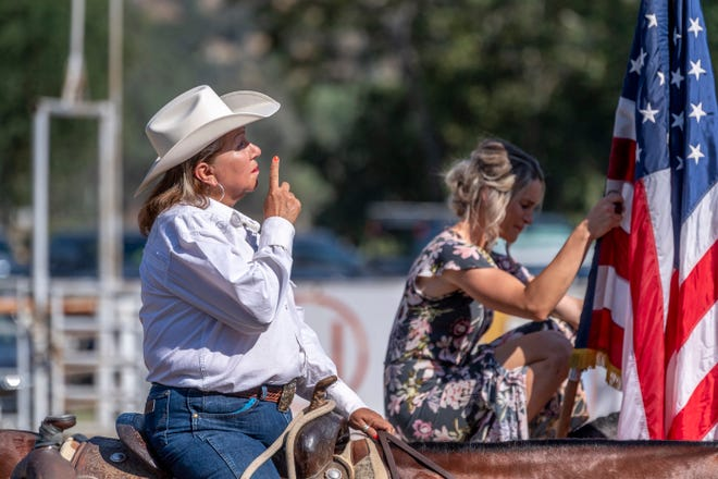 Suzie Sanchez-Medina pauses to think of Chad Nicholson before presenting the Riderless Horse Tribute for Nicholson at the Three Rivers Lions Club Roping Arena on Thursday, June 13, 2019. The beloved rodeo announcer and voice over artist died last month in a off-road accident in the Sierra foothills about 20 miles above Woodlake, near Badger.