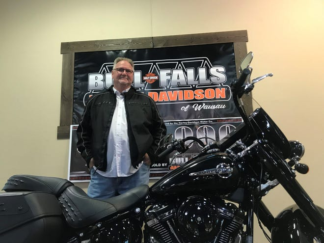Wayne Bartlett of Wisconsin Rapids made the motorcycle drive in the rain on Friday morning, June 14, 2019 to the Wausau Harley-Davidson dealership to receive gifts from the company after he purchased the 5 millionth bike manufactured by Harley-Davidson.