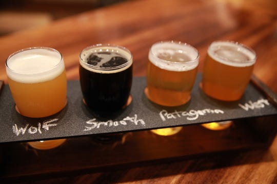 A beer flight at Wolf & Warrior in White Plains.